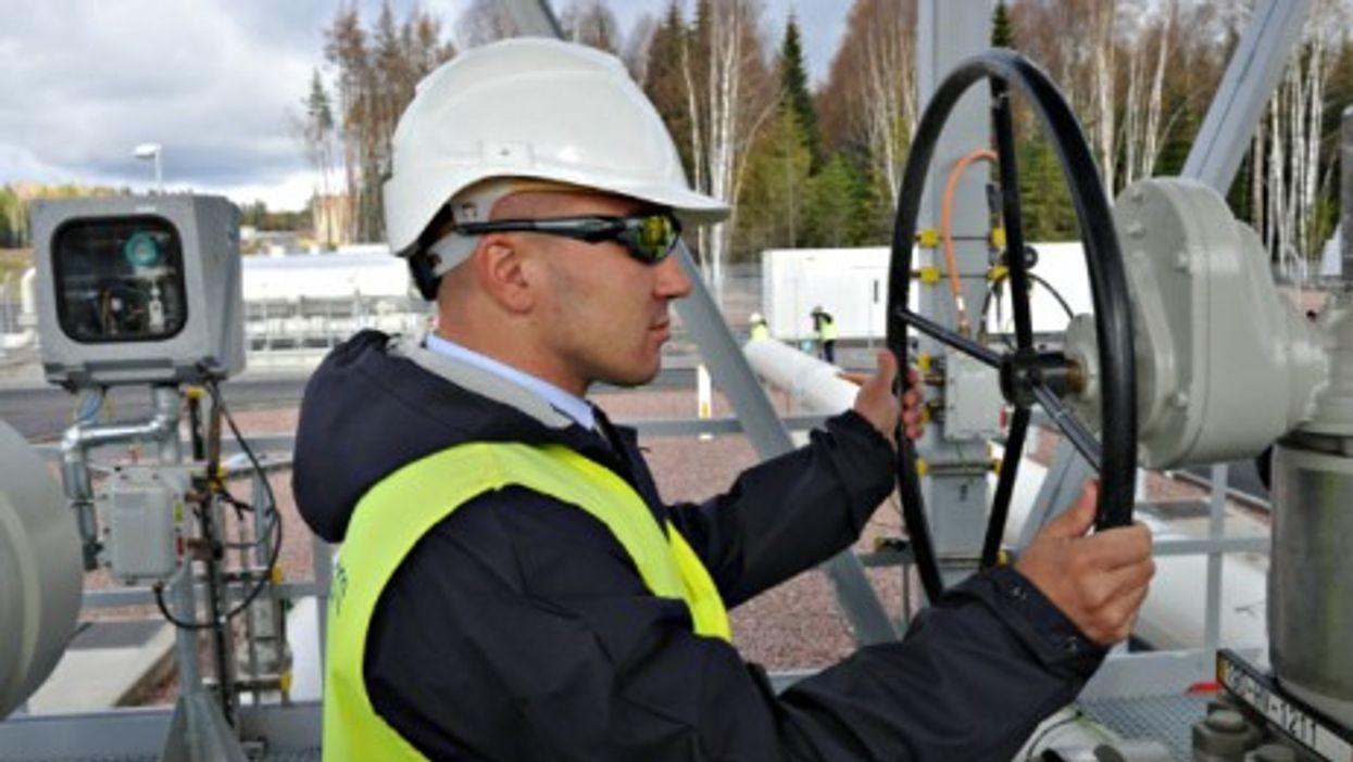 A pipeline operator in Portovaya bay, northwestern Russia,