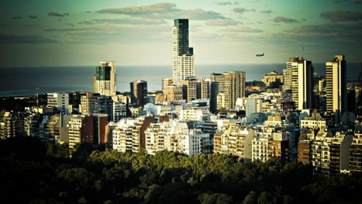 A plane flies over Buenos Aires