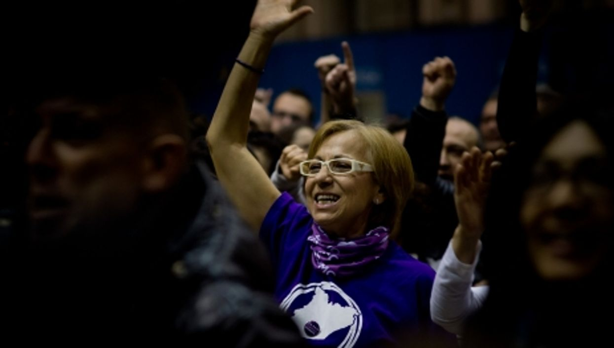 A Podemos supporter watching poll results in Barcelona