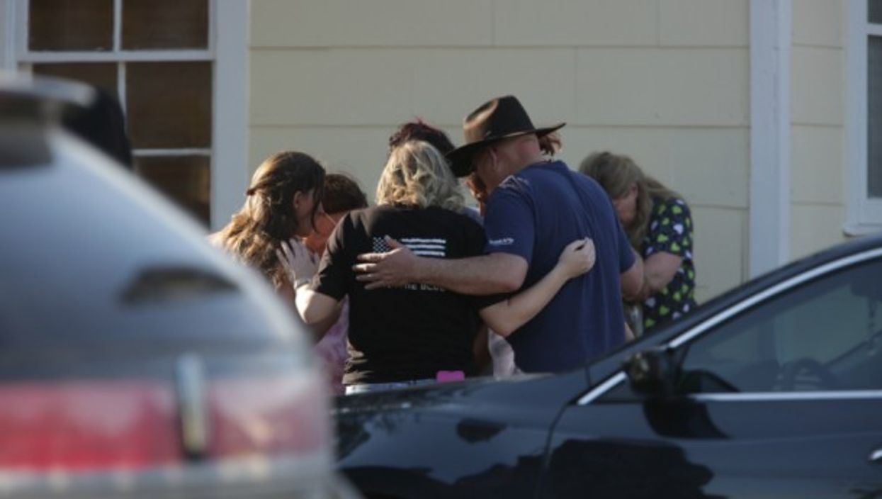 A prayer circle for the victims in Sutherland Springs, Texas