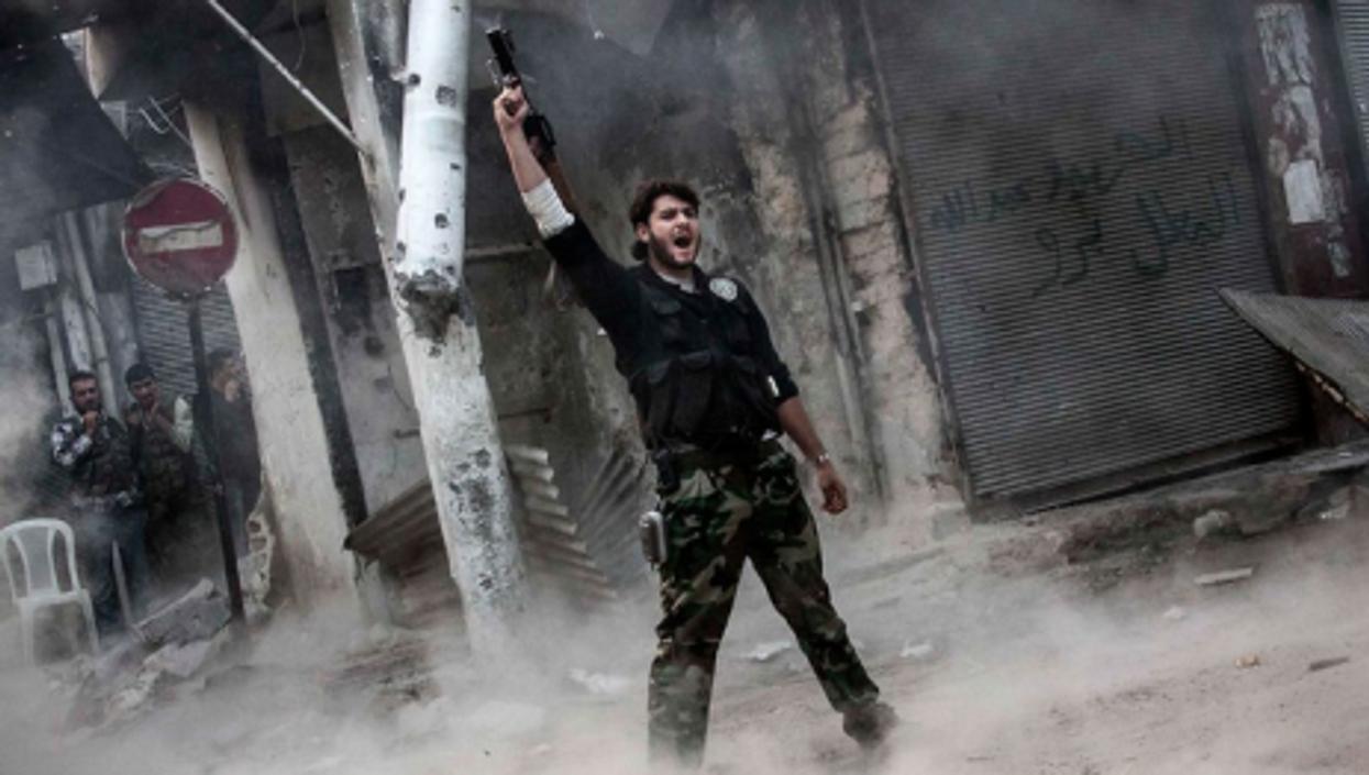 A rebel fighter after unloading his shoulder-fired missile toward Assad loyalists
