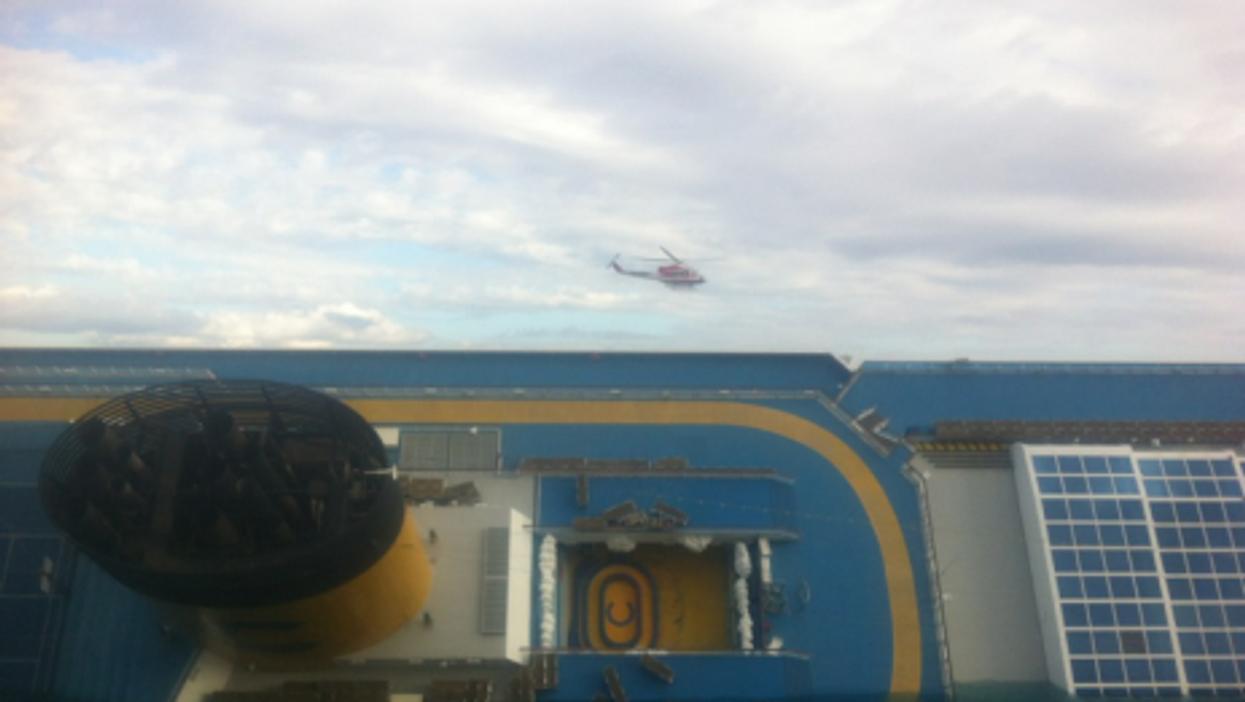 A rescue helicopter circles the sunken Costa Concordia cruise ship (Matthew Price)