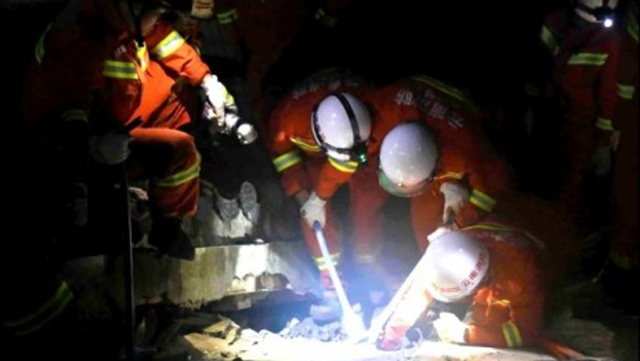 A rescue team in southwestern China after a 6.1-magnitude quake hit the area Sunday