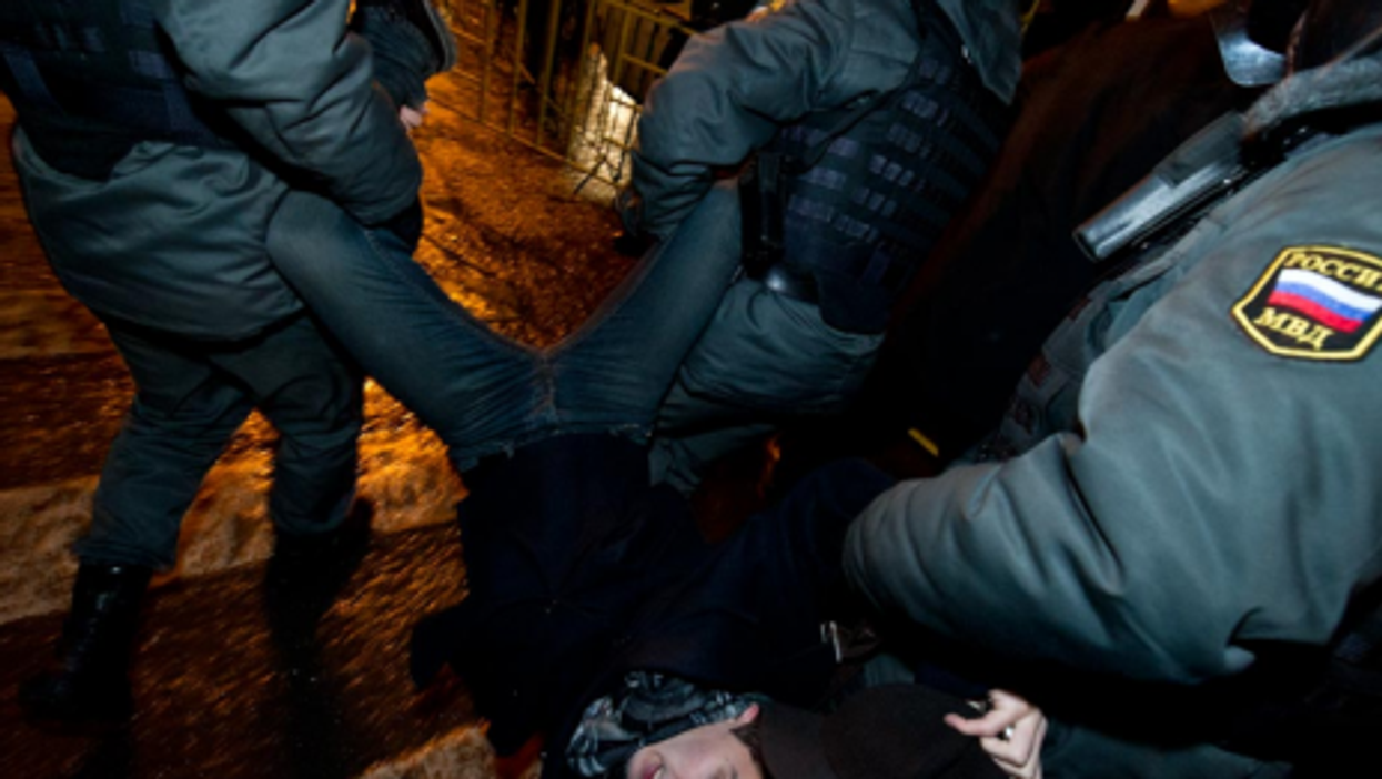 A Russia protester hauled away Sunday night (@adagamov)