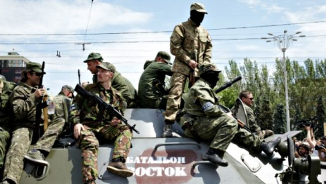 A Russian military unit parades in Donetsk on May 25