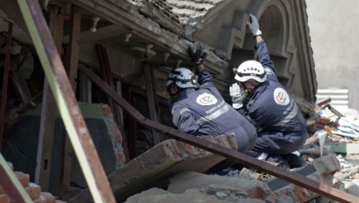 A search and rescue team searches for survivors in Kathmandu after the earthquake in Nepal, in March 2015.