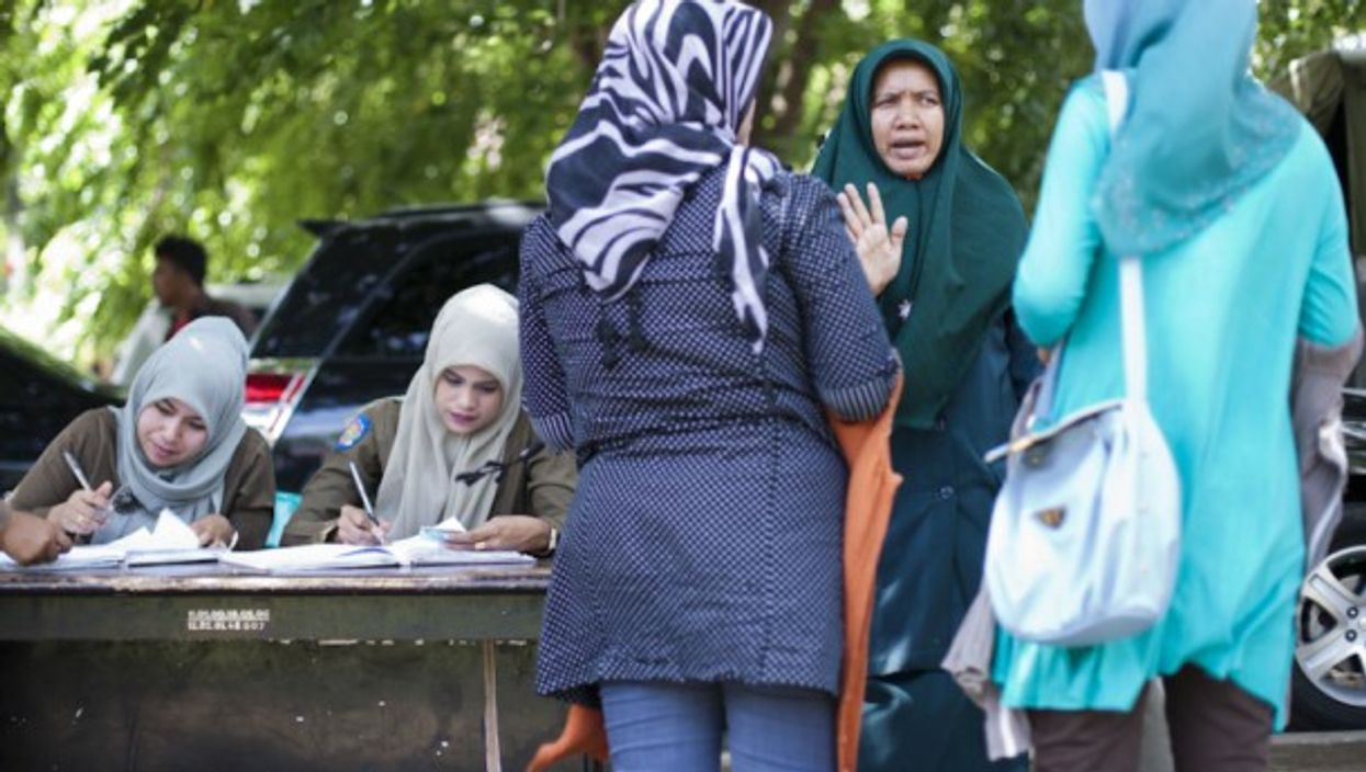 A Sharia policewoman (second from right) in Banda Aceh