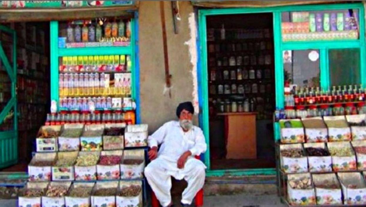 A shopkeeper selling herbal medicine in Kabul