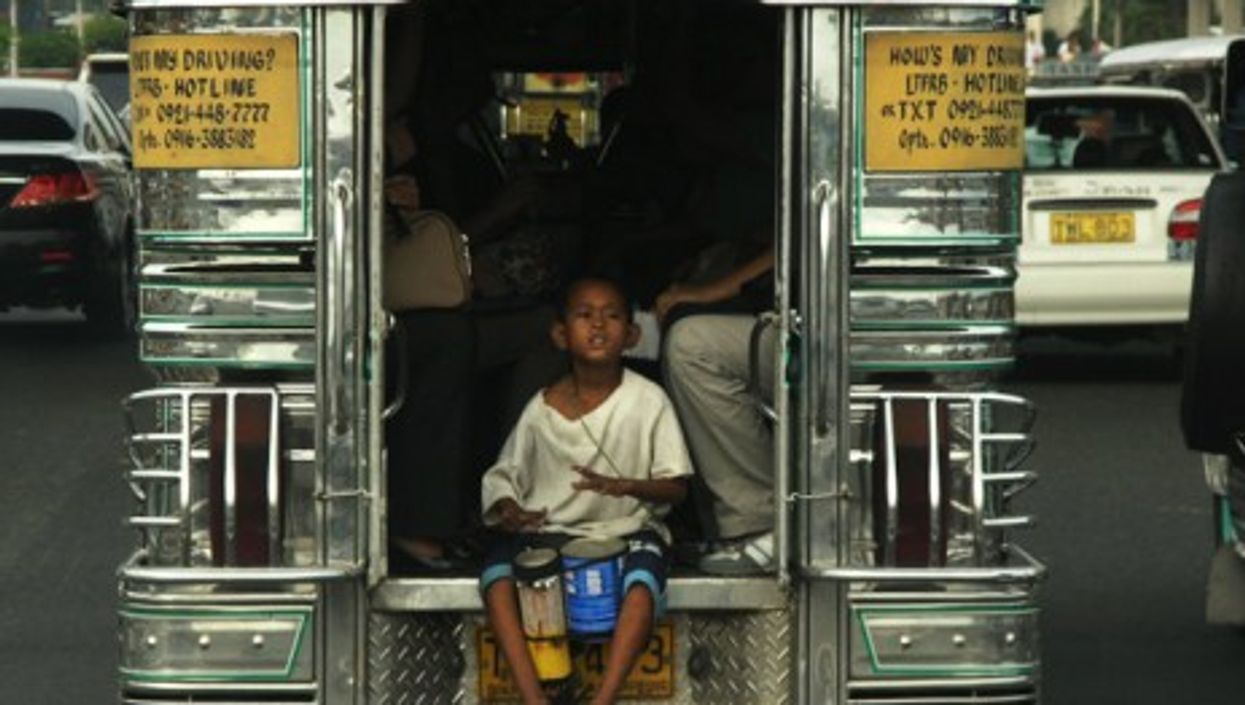 A slum kid in Manila (Roberto Verzo)