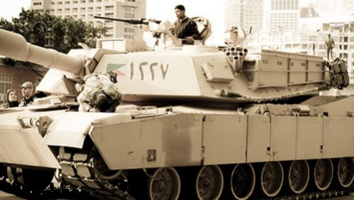 A soldier prays on a tank last month in Cairo