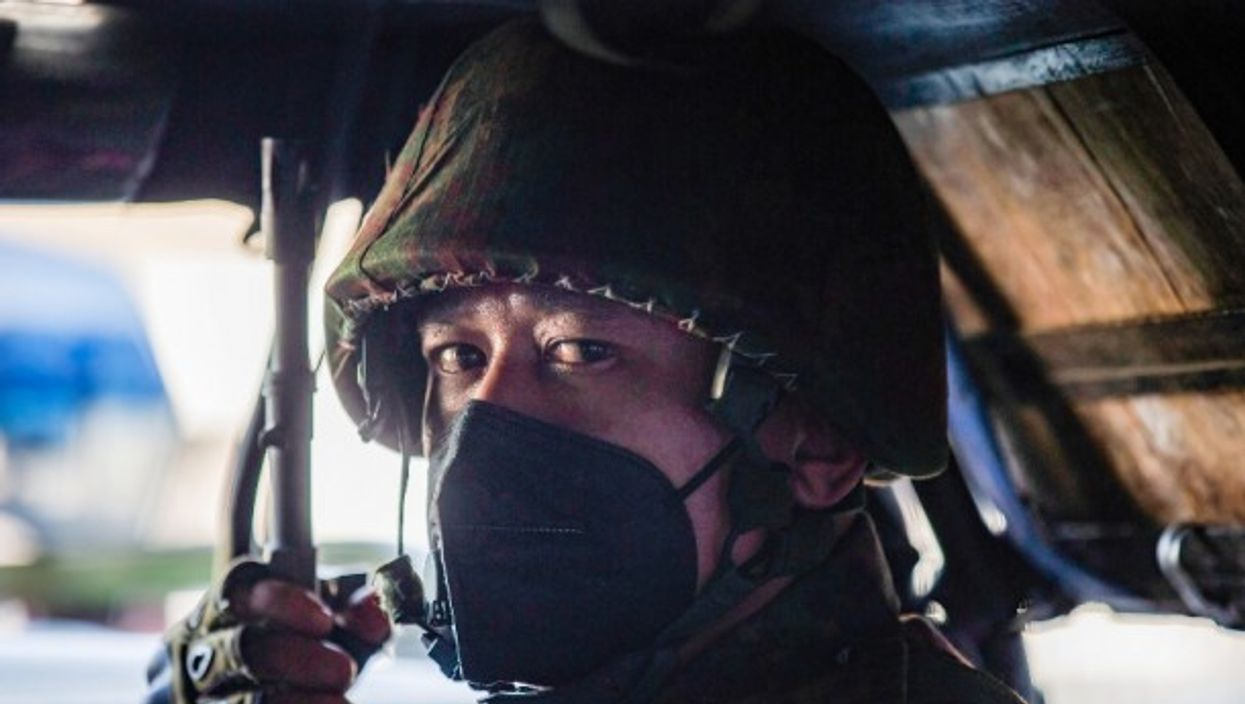 A soldier sits inside a military truck outside an Hindu temple in Yangon, Myanmar, where power has been handed to commander-in-chief Min Aung Hlaing following a military coup