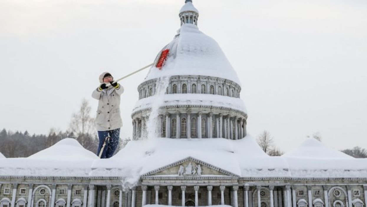 A staff member clears snow from a miniature replica of the U.S. Capitol in Miniwelt, a tourist attraction in Lichtenstein, eastern Germany.