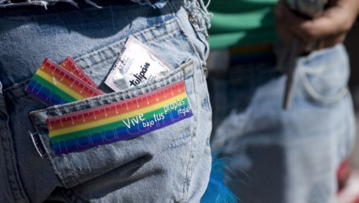 A sticker on the back of a marcher's jeans reads 'live under your own rules' and he carries a condom in his back pocket during the 17th annual gay, lesbian, transsexual and bisexual pride festival and march in the Plaza de Mayo in Buenos Aires, Argentina