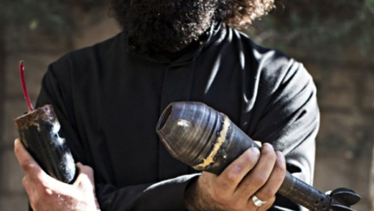 A Syrian bomb maker from Deir Al Zour, in eastern Syria, in 2013.