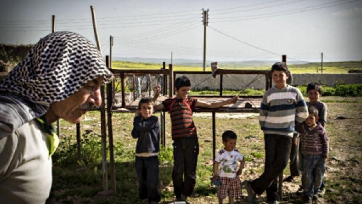 A Syrian Kurd family last April
