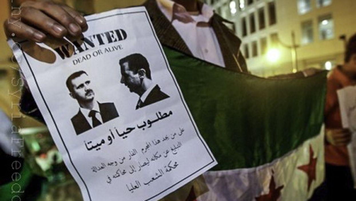 A Syrian Kurdish man protests against Bashar al-Assad