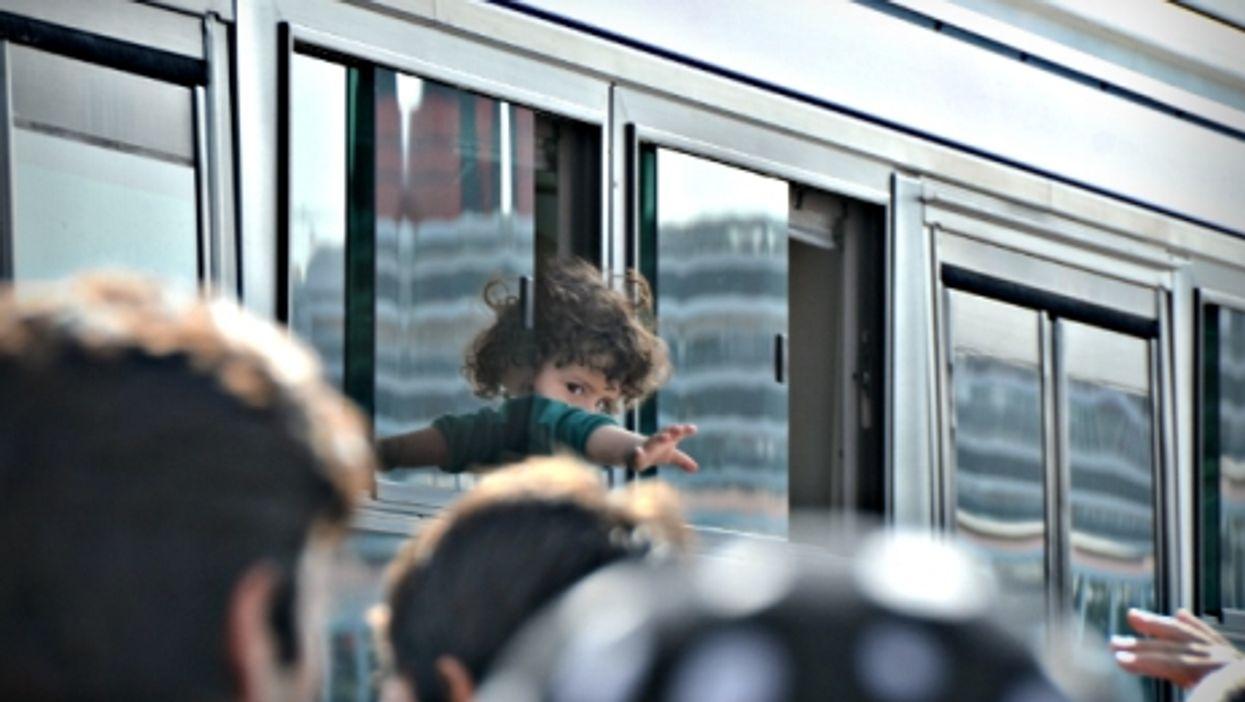 A Syrian refugee boy arriving in Athens on Sept. 6