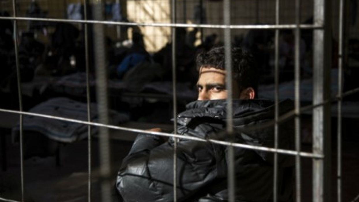 A Syrian refugee detained at a border police station in Bulgaria