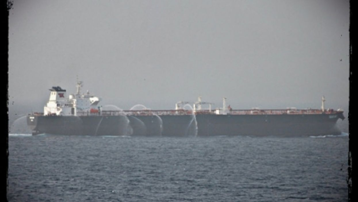 A tanker in the Gulf of Aden uses fire hoses to keep pirates away.