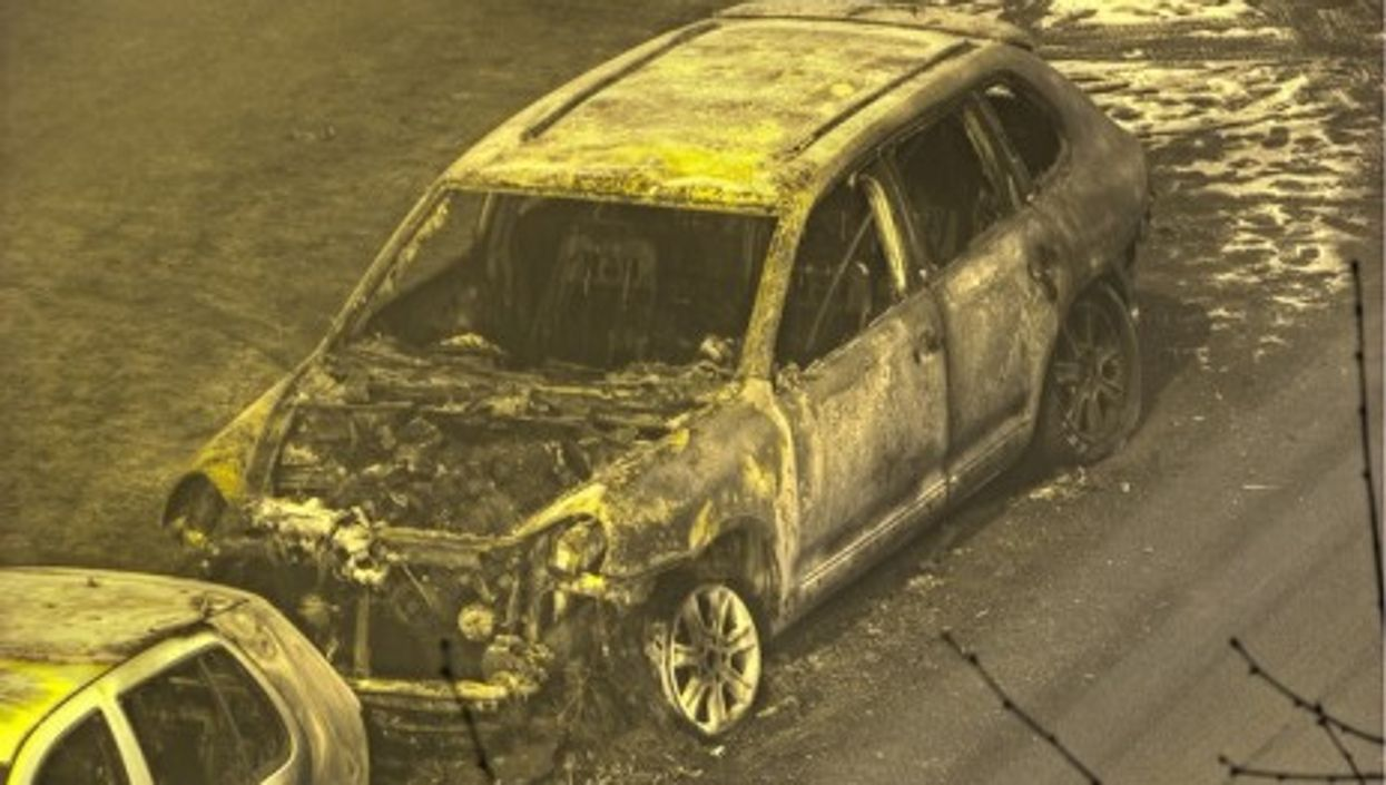 A torched luxury car in Berlin, Germany (2009)