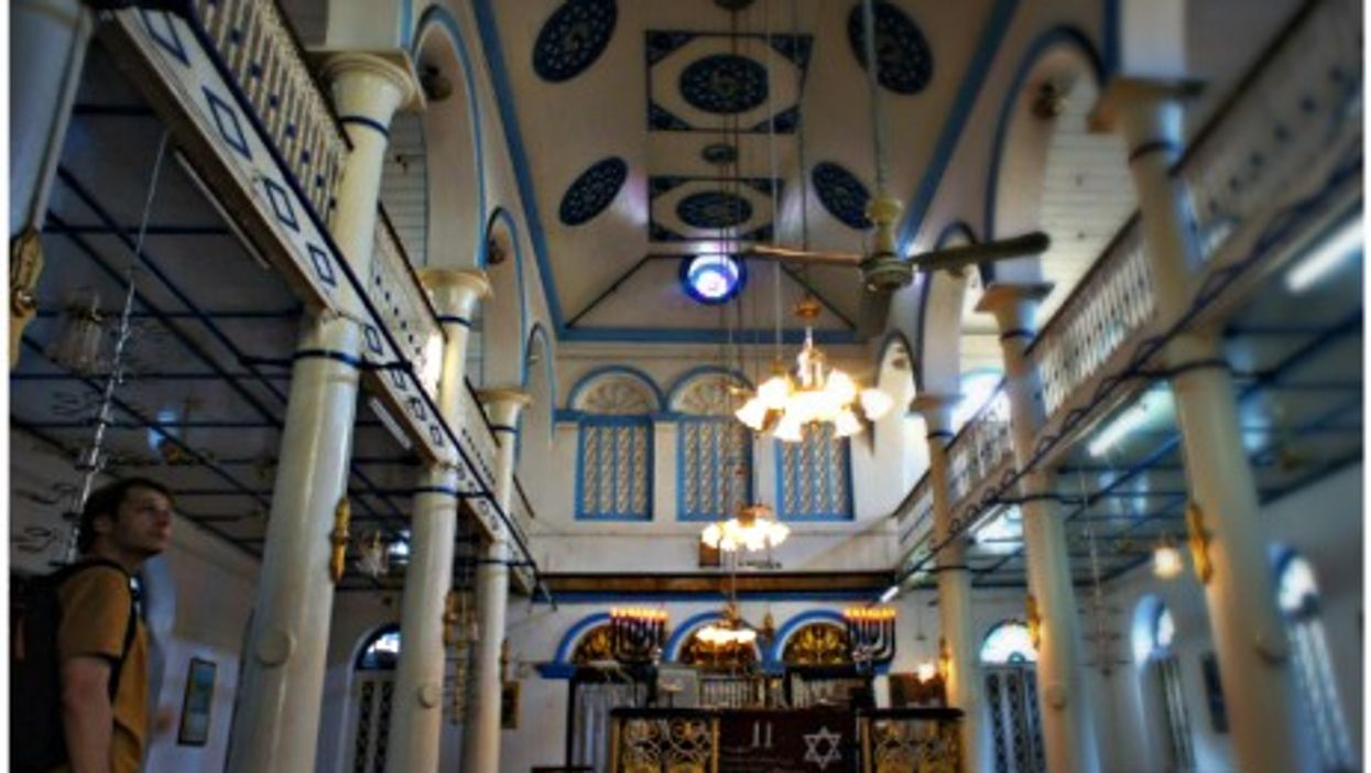 A tourist inside Yangon's Musmeah Yeshua, the last surviving synagogue in Myanmar