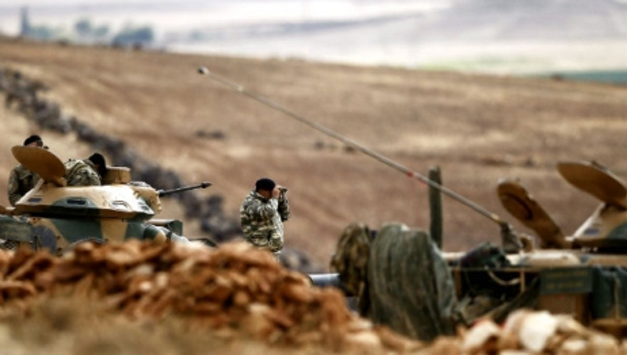 A Turkish army investigator looks over the Syrian border last October.