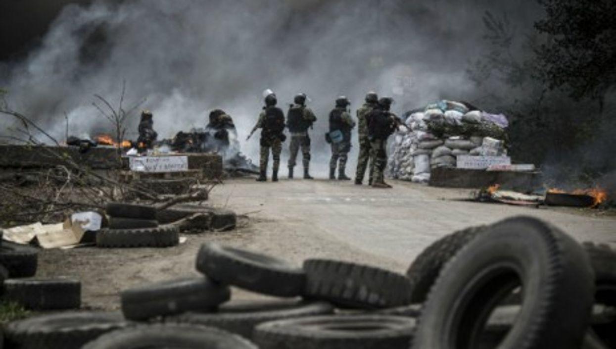 A Ukrainian commando moves on separatist barricades in Sloviansk, eastern Ukraine.