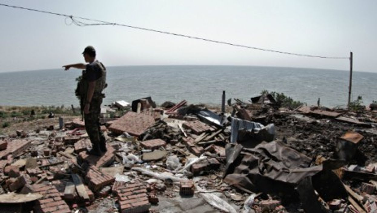 A Ukrainian soldier checks a site destroyed by Russian forces on Aug. 7.