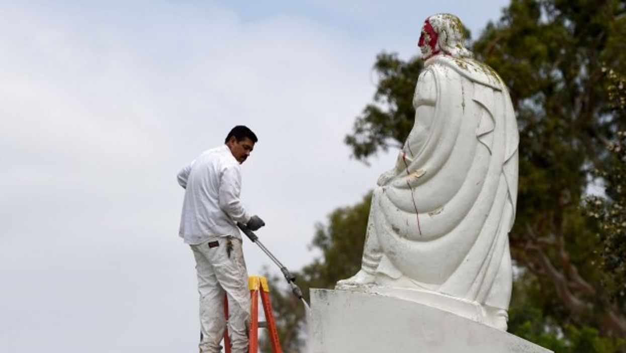 A vandalized Juan Rodriguez Cabrillo statue in San Pedro, California, is cleaned