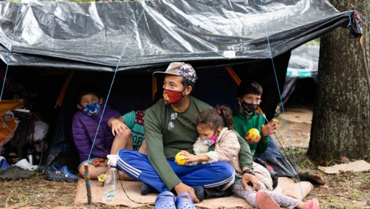 A Venezuelan family in a makeshift migrant camp in Bogota, Colombia
