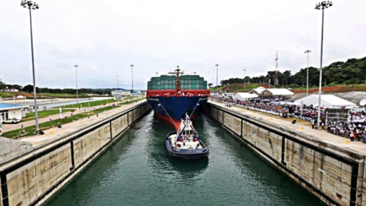 A vessel passes through the Panama Canal in the city of Colon.