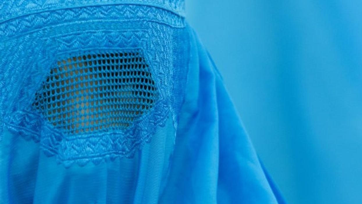 A visitor wearing a burqa at the 2012 exhibition 'Burquoi' at the Kunstverein in Wiesbaden, Germany.