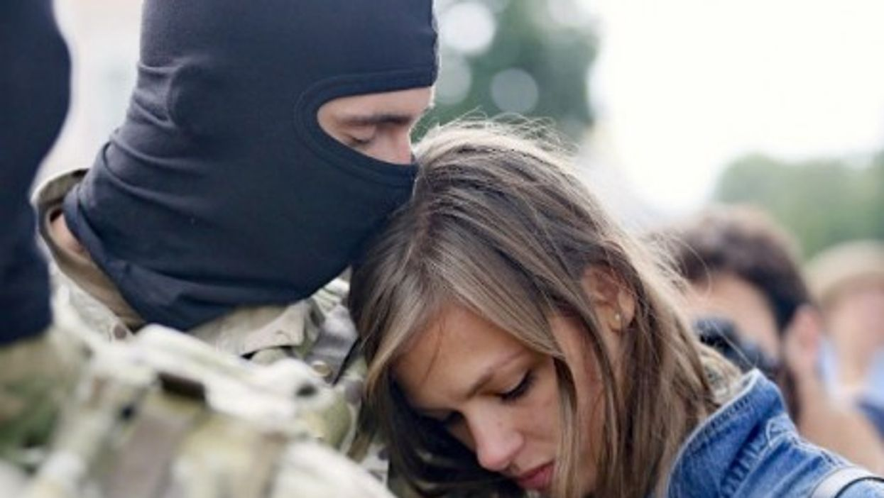 A volunteer in Kiev says goodbye to his loved one before being sent to eastern Ukraine to join the ranks of special battalion Azov.