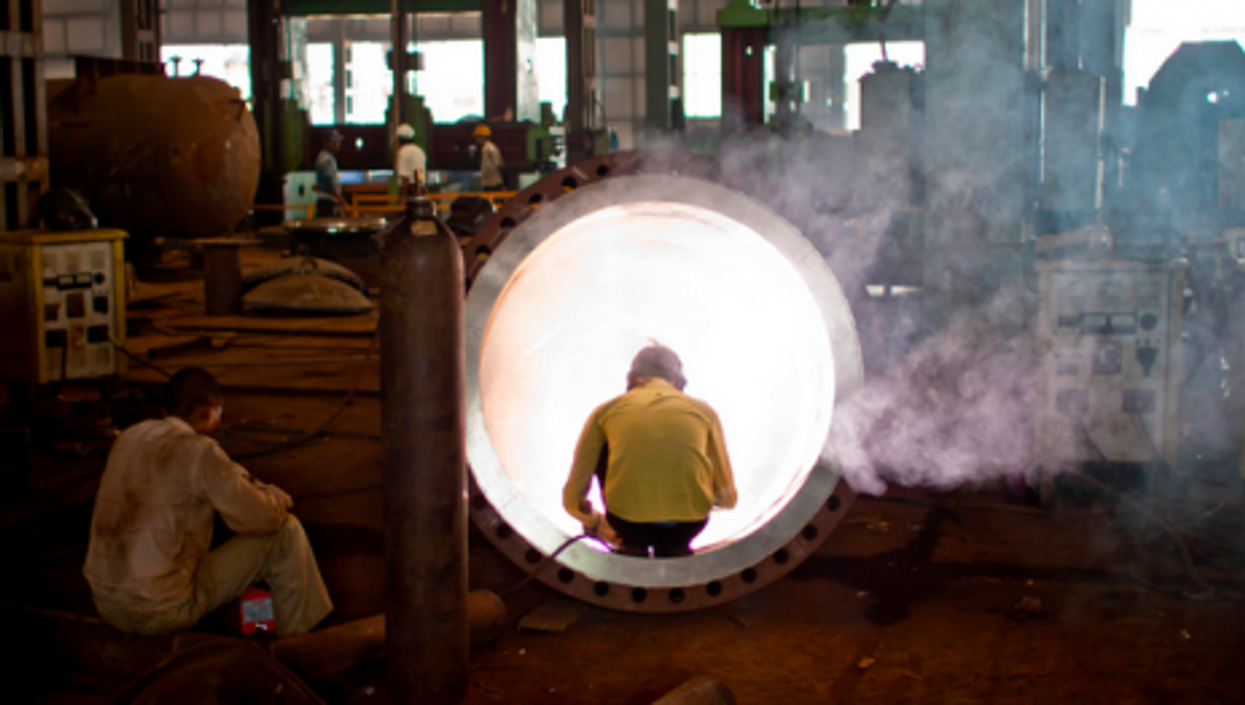 A welder in an Indian factory