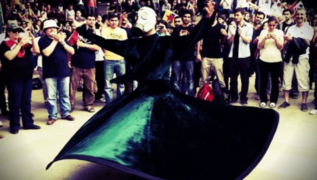A whirling sufi protesting in Ankara on June 2