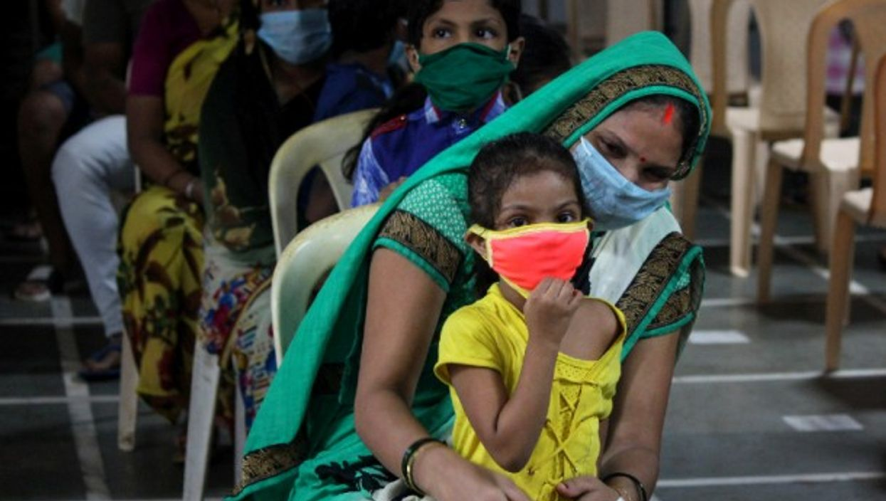 A woman and her daughter wait to get tested for the coronavirus.