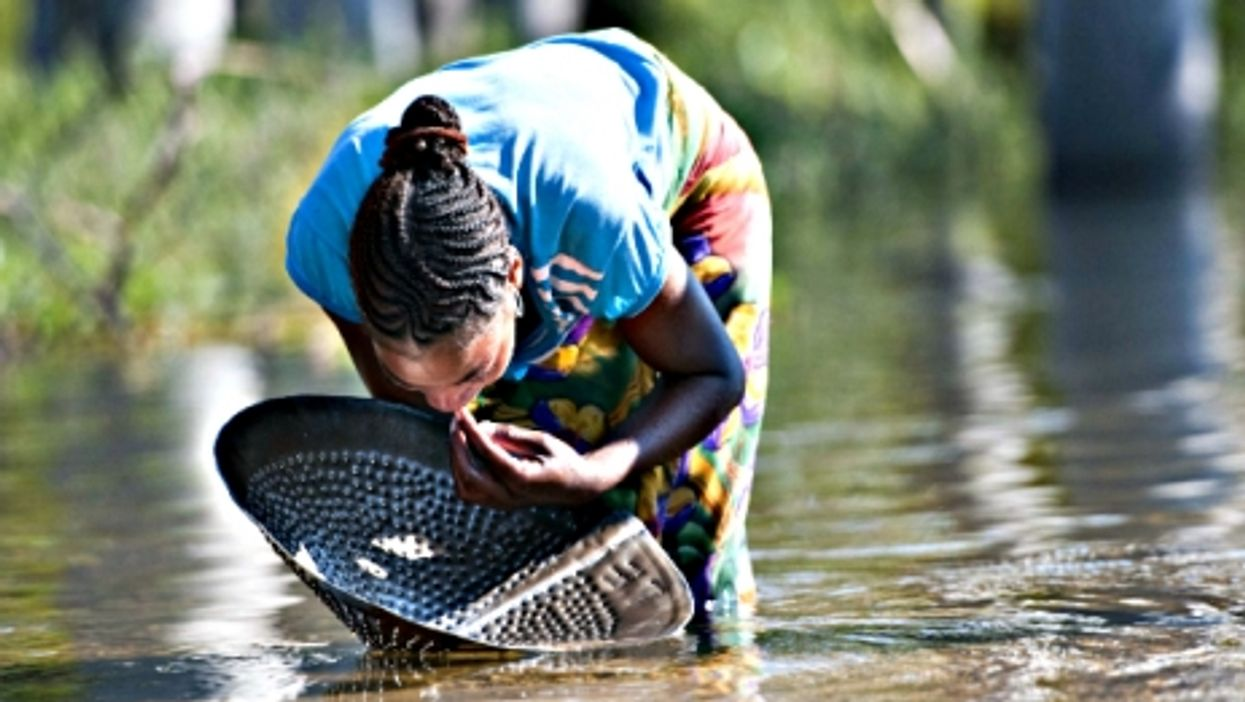 A woman looks for sapphire in a river in Ilakaka in southwest Madagascar
