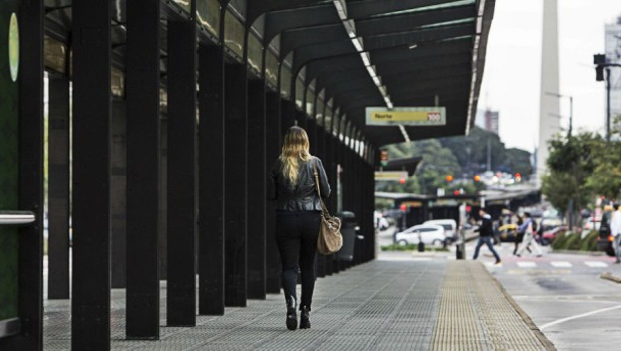 A woman walking through a bus station in Buenos Aires