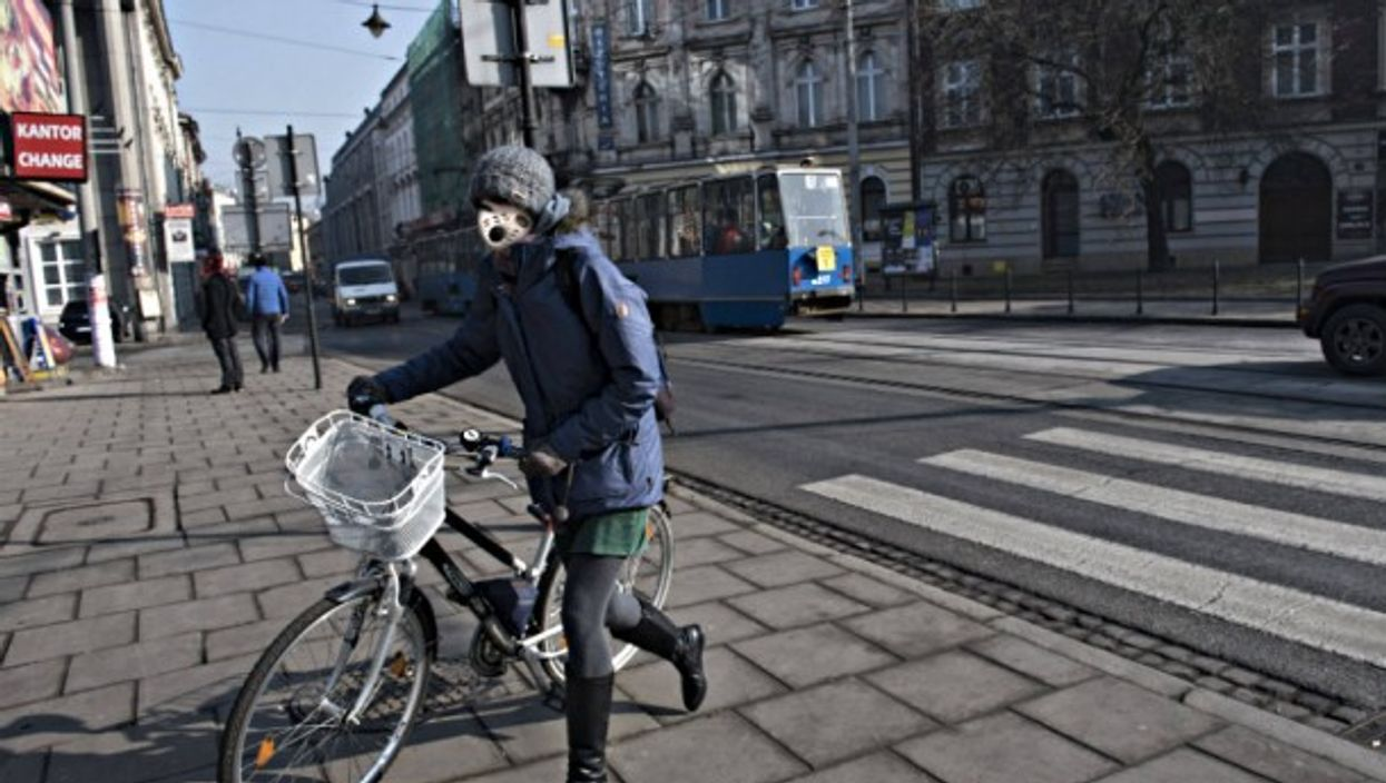 A woman wears a mask in Krakow earlier this month