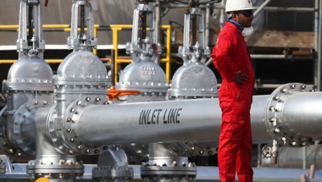 A worker at an oil processing facility of Saudi Aramco, a Saudi Arabian state-owned oil and gas company