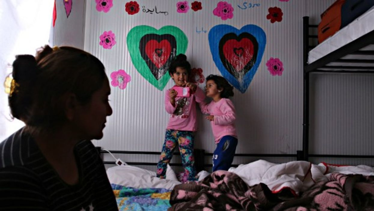 A Yazidi mother and her daughters in a refugee camp in Greece