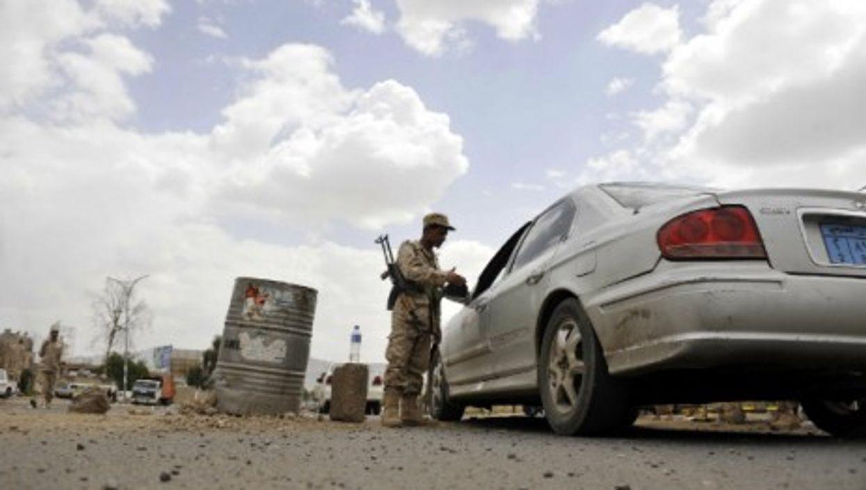 A Yemeni soldier checks a car in Sanaa, Yemen, on May 6, 2014 — Mohammed Mohammed/Xinhua/ZUMA