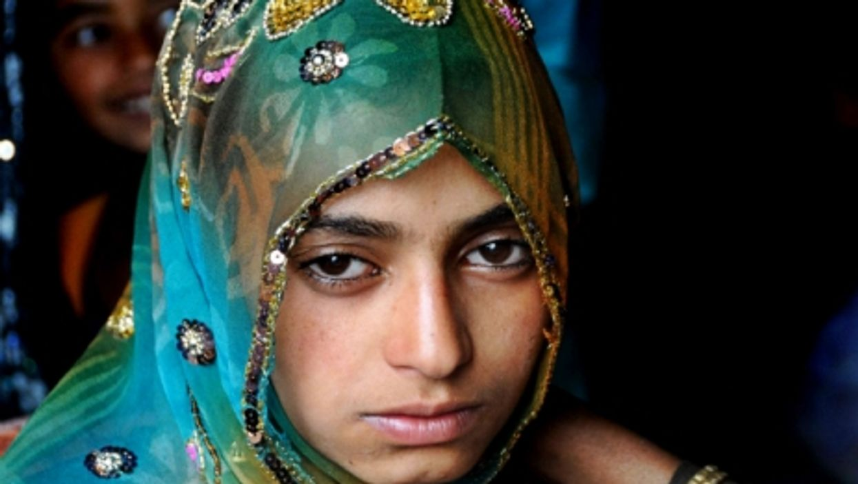 A young bride waits for her bridegroom.