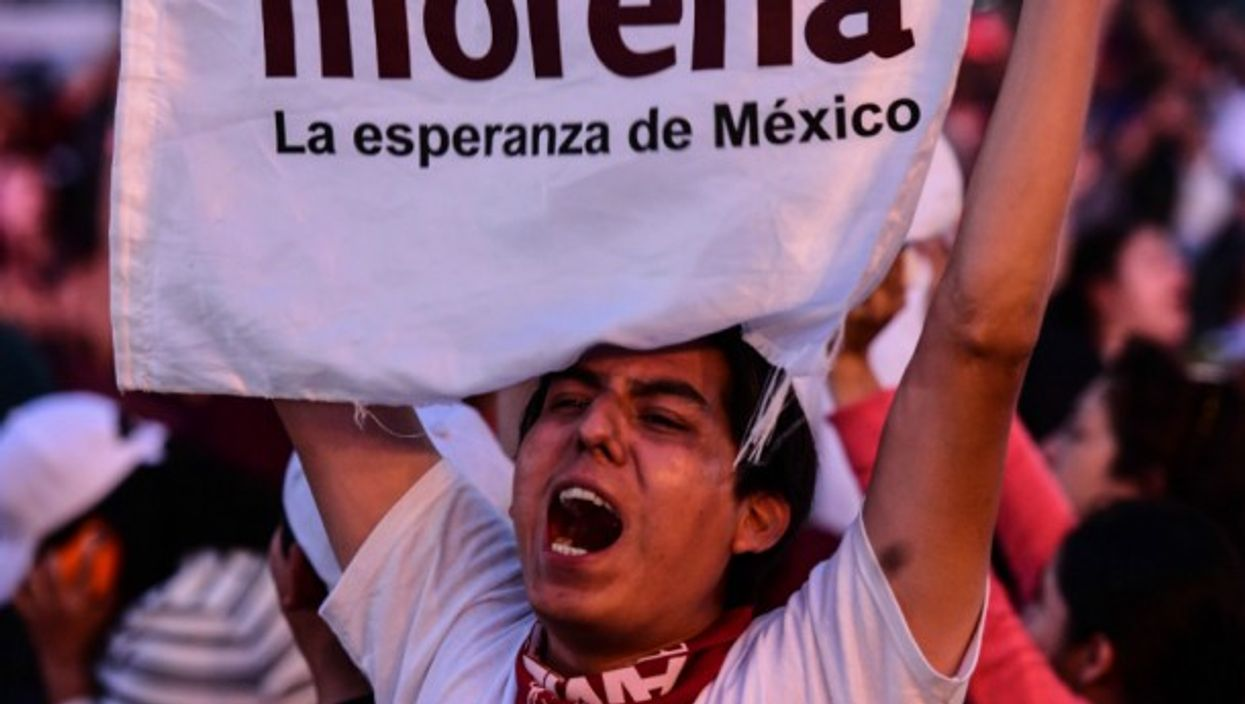 A young man cheers to presidential candidate Manuel Lopez Obrador at a rally in Mexico on June 27