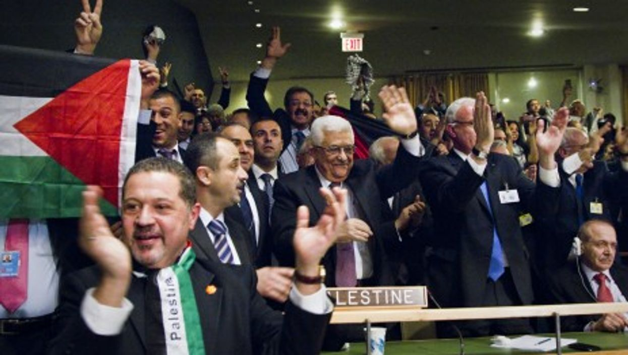Abbas with his delegation following the UN decision