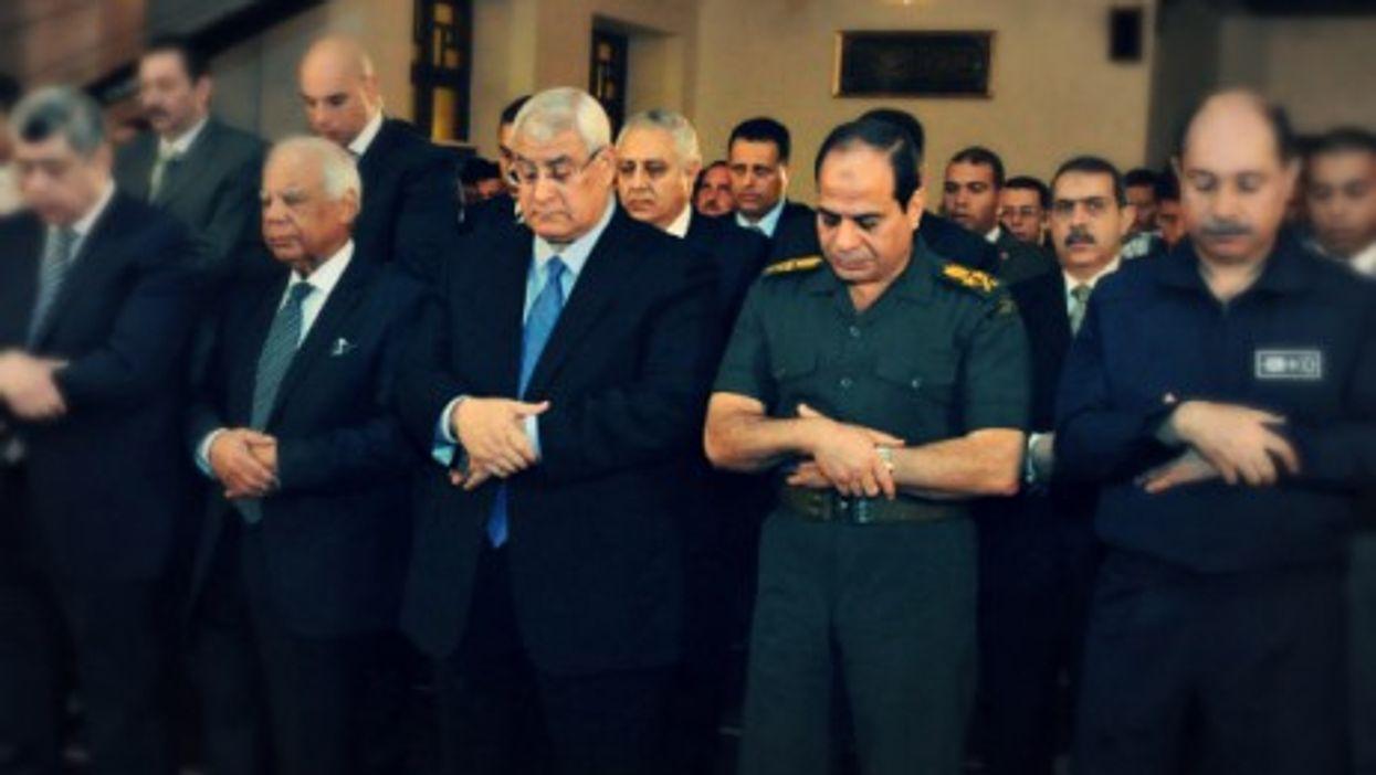 Abdel Fattah al-Sisi praying at a Cairo mosque in October 2013.