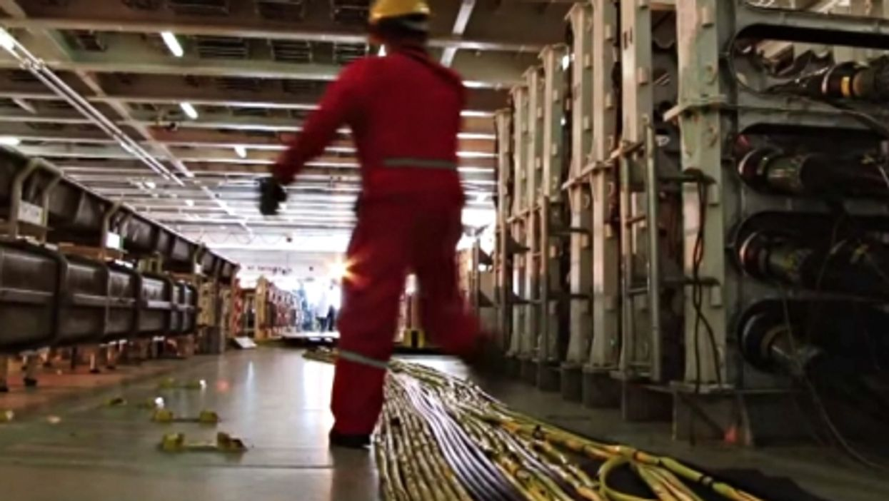 Aboard a submarine cable ship