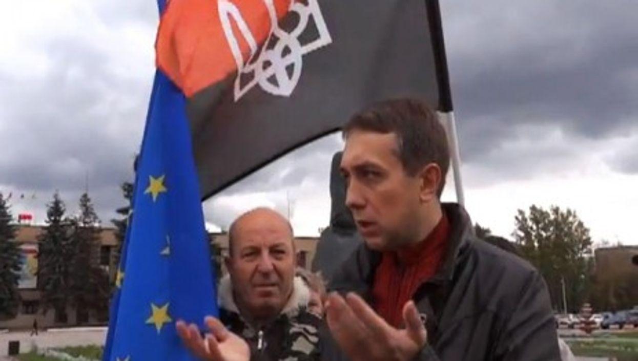 Activist Evgenii Arkhipov before the Russian Democratic Republic of Domodedovo flag