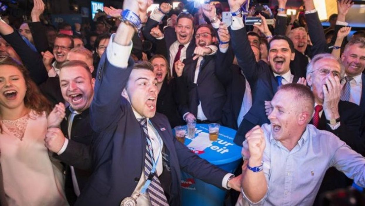 AfD supporters react to election results in Berlin on Sept. 24