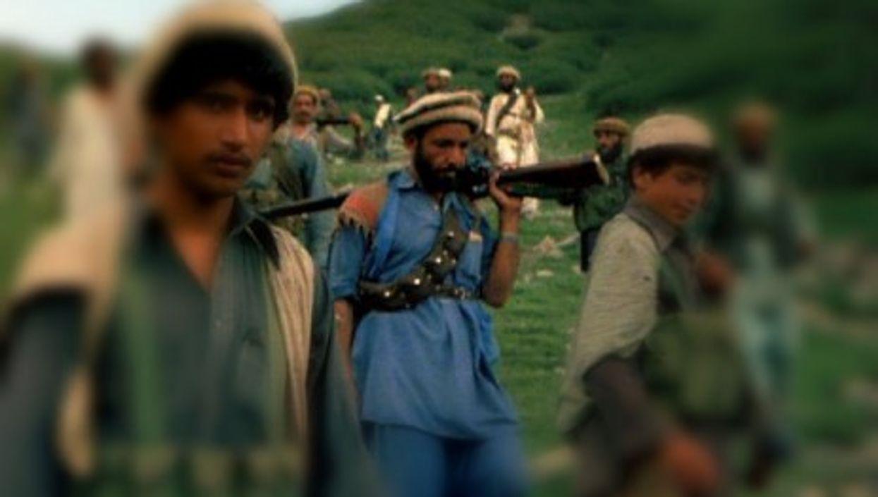 Afghan Mujahideen near the Pakistan border, 1985